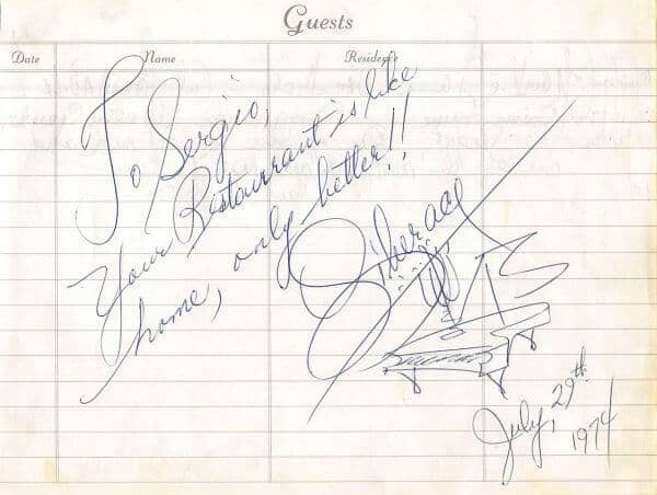 Liberace with signature and Hand Drawn Piano Trademark